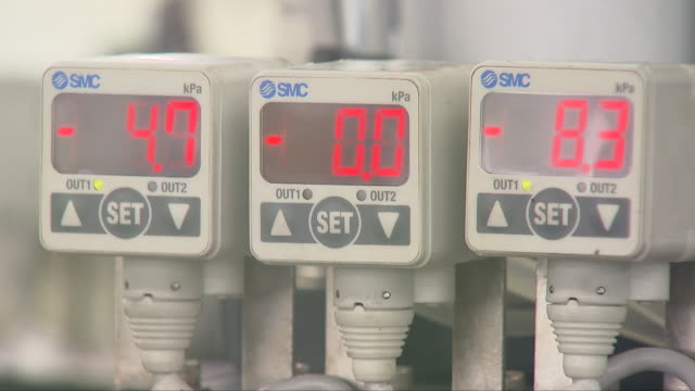 contact lens being heated up at a manufacturing factory - contact lens stock videos and b-roll footage