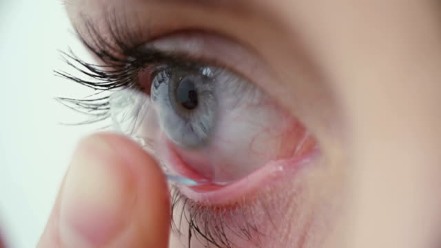 contact lens - inserting stock videos & royalty-free footage