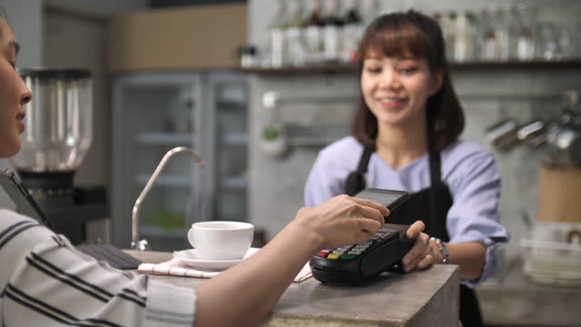 contactless payment at cafe - 18 19 years stock videos & royalty-free footage