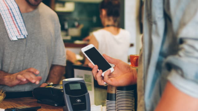 contactless payment in the cafeteria - buy single word stock videos & royalty-free footage