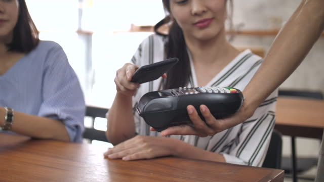 contactless payment in the cafeteria - paying card stock videos & royalty-free footage
