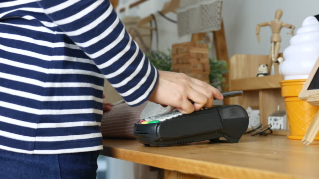 Contactless Payment with Mobile Phone in a shop, Dolly shot
