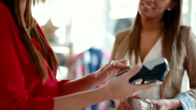 contactless payment with mobile phone in a shop - paying stock videos and b-roll footage