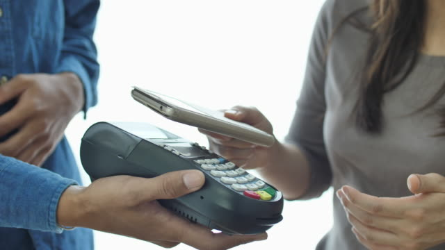 SLO MO Contactless Payment with Mobile Phone in a shop