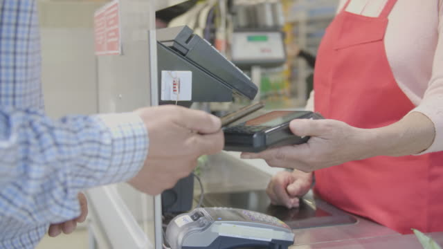 contactless payment with smart phone - paying stock videos & royalty-free footage