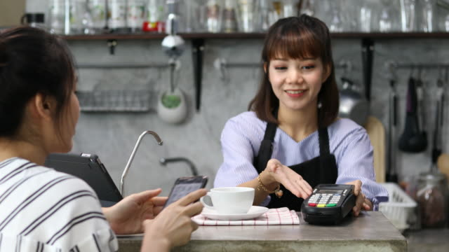 contactless payment with smartphone - contactless payment stock videos & royalty-free footage