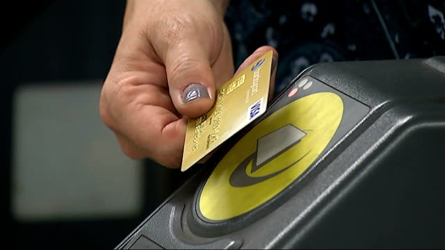 contactless payments begin on london underground england london int close shot oyster card being scanned on card reader at ticket barrier close shot... - contactless payment stock videos & royalty-free footage