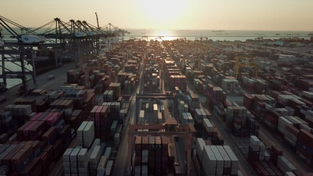 container cargo in port at sunset - port of los angeles stock videos & royalty-free footage