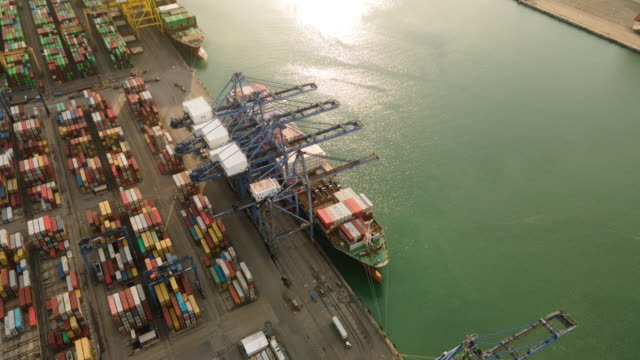 container , container ship in export and import business and logistics. shipping cargo to harbor by crane. water transport international. aerial view and top view. - ship stock videos & royalty-free footage