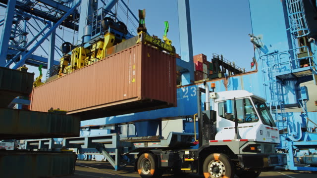 container crane loading ship - cargo container stock videos & royalty-free footage