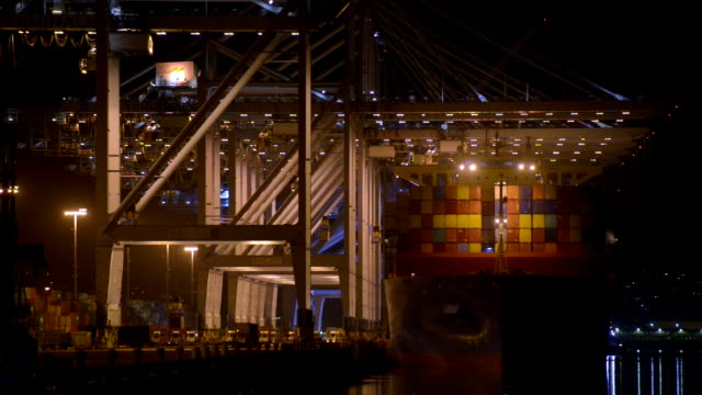 container cranes working on industrial ship - anchored stock videos & royalty-free footage