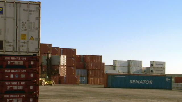 ws container handler carrying cargo containers in container yard/ sydney, australia - medium group of objects stock videos & royalty-free footage