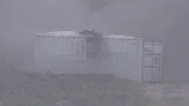 a container is shot and blows up. - container stock videos & royalty-free footage