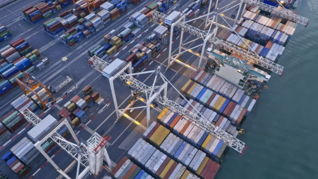 aerial container port at dusk - docks stock videos & royalty-free footage