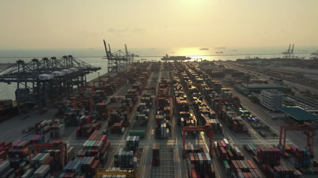 container port in sunset - trucking stock videos & royalty-free footage