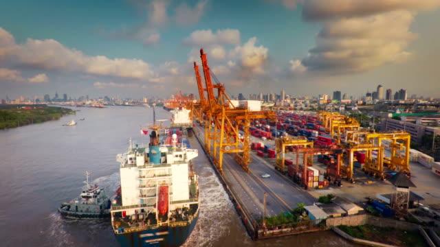 container ship arrive at bangkok port terminal : aerial shot - cargo ship stock videos & royalty-free footage