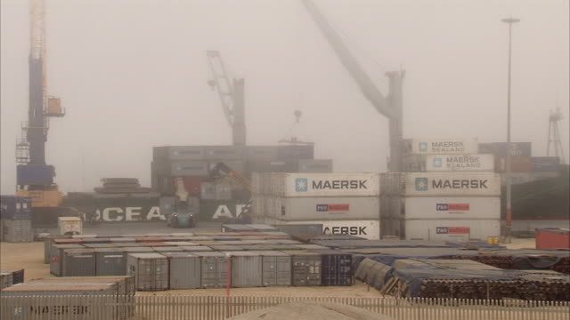 WS TS PAN Container ship being offloaded in heavy fog / Luderitz, Namibia