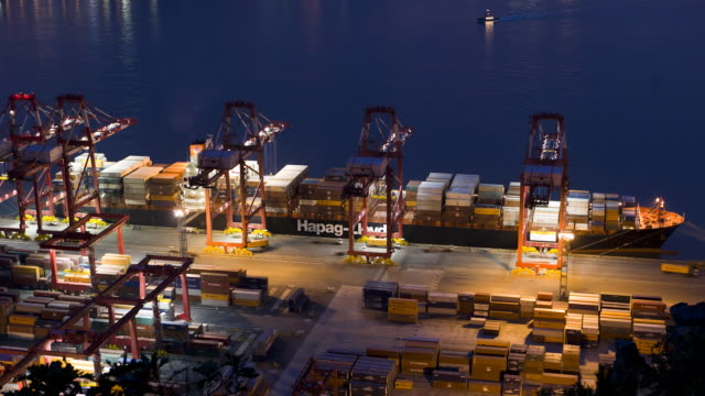 TL, HA, MS Container ship being unloaded at dusk at Busan Port / Busan, South Korea