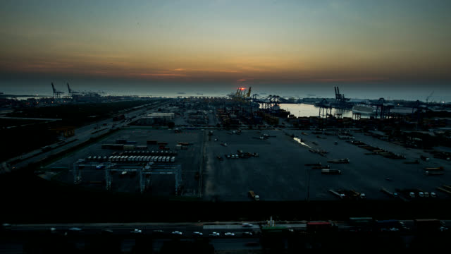 container ship berthing port at dusk. - orthographic symbol stock videos and b-roll footage