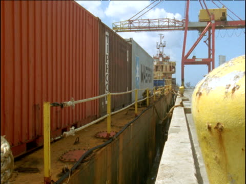 Container ship bobs up and down moored in dockyard, Guam