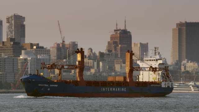 a container ship crosses the hudson river with manhattan behind. - harbor stock videos & royalty-free footage