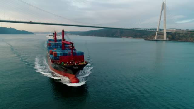 container ship crossing through the yavuz sultan selim bridge aerial drone footage - istanbul /4k - yavuz sultan selim bridge stock videos & royalty-free footage