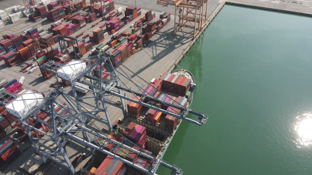container ship drone aerial in export and import business and logistics. shipping cargo to harbor by crane. water transport international. aerial view - docker stock videos & royalty-free footage