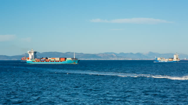 ws container ship entering piraeus harbour of athens - frachtschiff stock-videos und b-roll-filmmaterial
