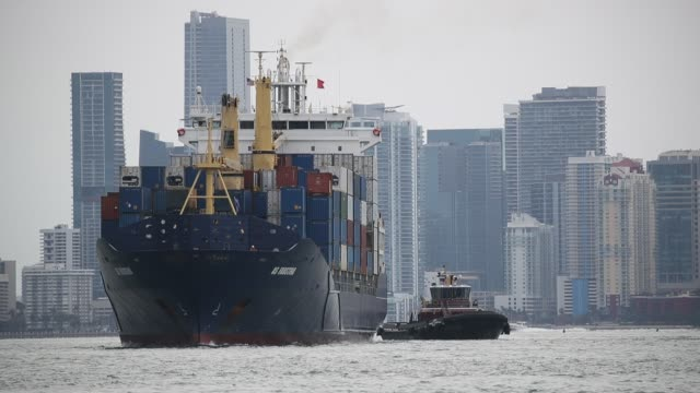 A container ship heads out to sea from PortMiami as the government issued a report that showed the US economy grew at an annual rate of 23 percent in...