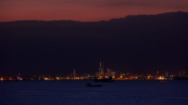 container ship in front of yokohama. - bay of water stock videos & royalty-free footage