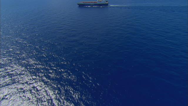 LOW AERIAL Container ship in ocean near Bimini, Bahamas
