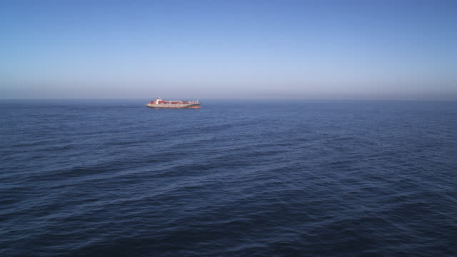 a container ship in open ocean - artbeats stock videos & royalty-free footage