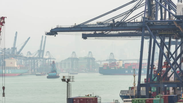 Container ship in the harbor in Asia, Tilt down time lapse 4k.