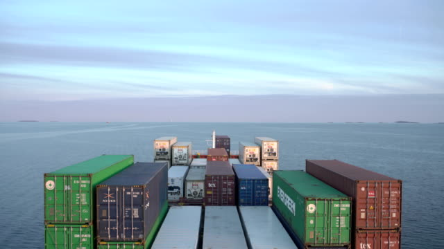 container ship in the north sea (dusk) - cargo container stock videos & royalty-free footage