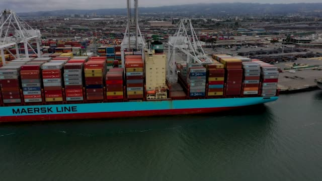 a container ship sits docked at the port of oakland on may 13 2019 in oakland california china retaliated to us president donald trump's 25 percent... - trade war stock videos & royalty-free footage