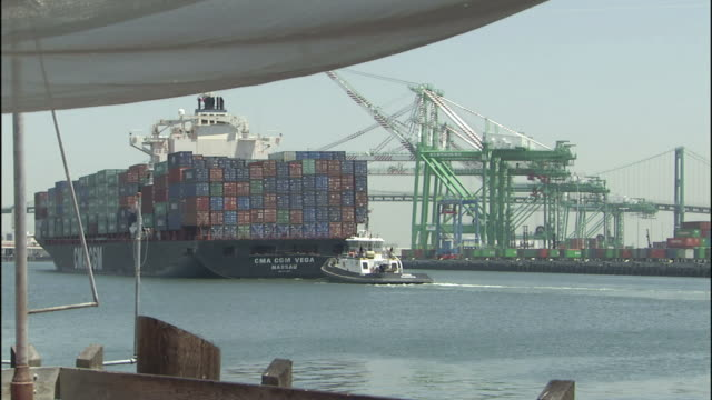 A container ship slowly cruises into the Port of Los Angeles.