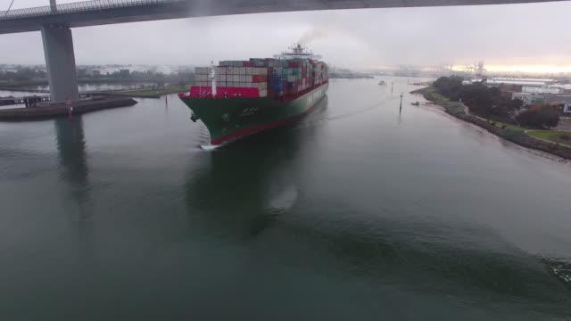 container ship travels under westgate bridge melbourne - david ewing stock-videos und b-roll-filmmaterial