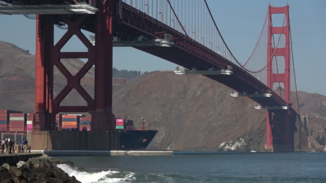container ship under the golden gate bridge - san francisco bay stock videos & royalty-free footage
