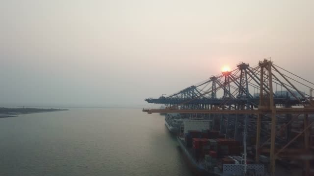 Container ship unloading at the port