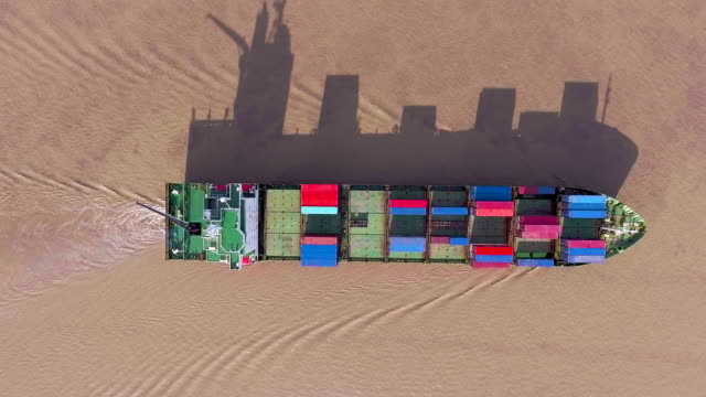 container ship with long shadow, aerial top view with drone - shadow stock videos & royalty-free footage