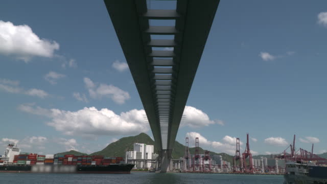 container ships converging underneath tsing ma bridge - below stock videos & royalty-free footage