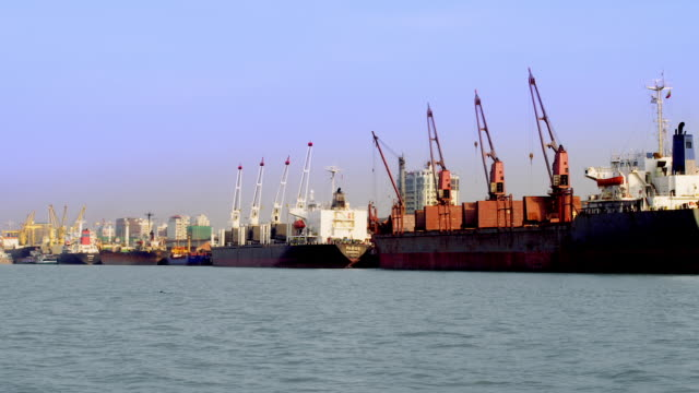 Container ships unloading at Yangon Harbour