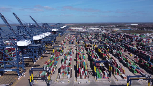 container stacks at the port of felixstowe. aerial tracking shot. - construction machinery stock videos & royalty-free footage