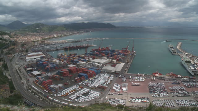 WS Container terminal with cityscape and skyline on ocean / Salerno, Campania, Italy