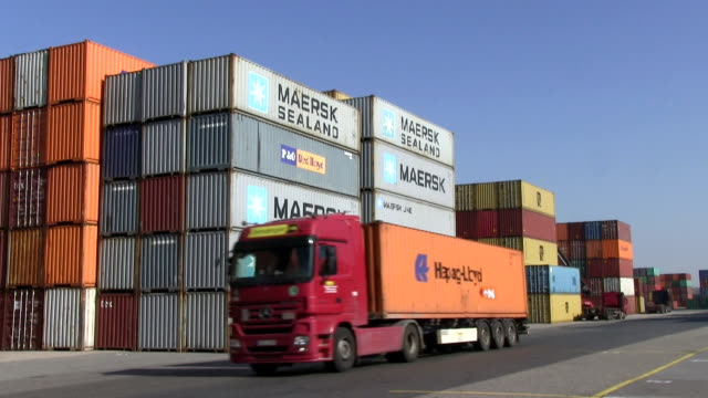 MS Container truck moving on container terminal at Wörth harbour, Rhine River / Wörth, Rhineland Palatinate, Germany