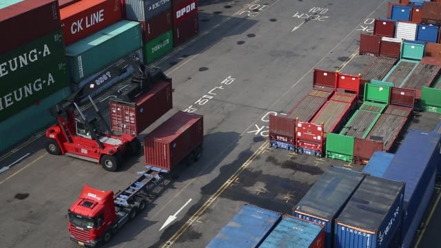 Container trucks drive past the Sun Kwang Newport Container Terminal in Incheon New Port in Incheon South Korea on Thursday Sept 1 A container...