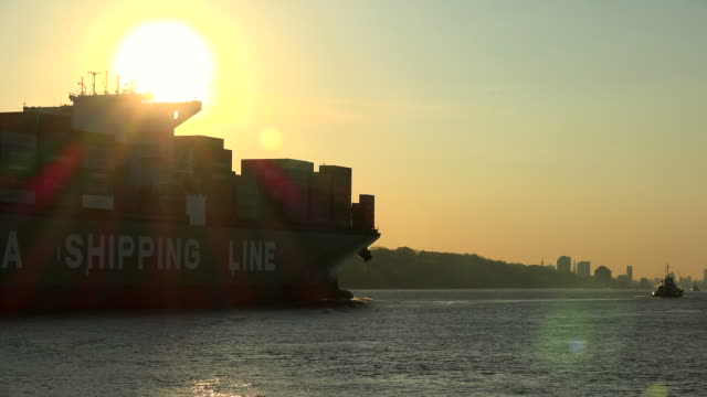 container vessel arriving at harbour of Hamburg, Elbe River, Germany