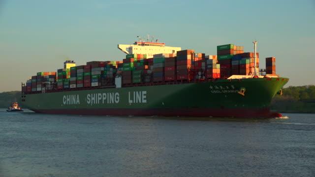 container vessel at Elbe River, Hamburg-Finkenwerder, Germany