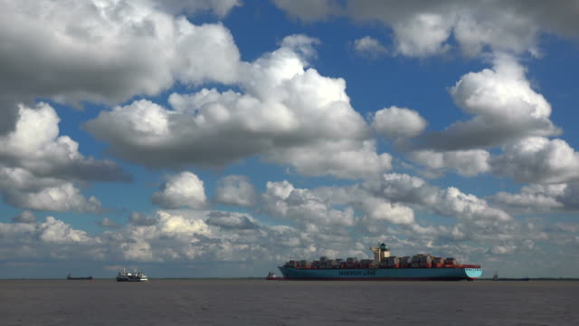 Container vessel on Elbe River near Brunsbüttel, Schleswig-Holstein, Germany