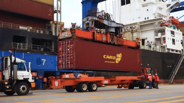 containers are loaded onto the praha ship in the seagirt marine terminal at the port of baltimore in baltimore maryland us a ship to shore crane arm... - port of baltimore stock videos & royalty-free footage